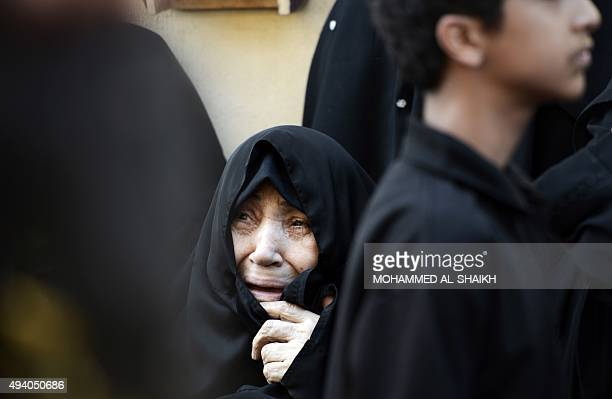A Bahraini Shiite Muslim woman mourns during a ceremony marking Ashura which commemorates the seventh century slaying of Imam Hussein the grandson of...