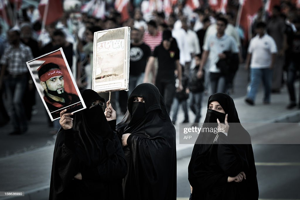 Bahraini Shiite Muslim women take part in an anti-government demonstration in the western Manama suburb of Jidhafs, on December 22, 2012. Thousands of Shiite protesters in Bahrain demanded a transition government and the removal of Prime Minister Sheikh Khalifa bin Salman al-Khalifa, who has been premier since 1974, witnesses said.