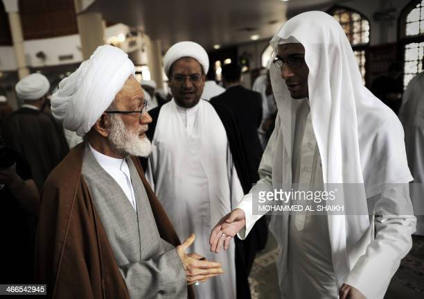 Bahraini top senior Shiite cleric Sheikh Isa Qassim speaks with a fellow cleric during a protest against the closing down of a Shiite Muslim clerics'...