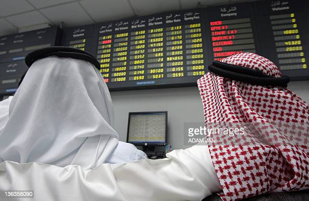 Bahraini traders follow the market's movement at the Stock Exchange in Manama on December 2 2009 Gulf stock markets steadied after heavy losses in...