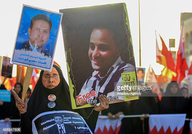 Bahraini woman holds the photo of jailed Abu Deeb the founder and leader of Bahrain Teachers' Association which played an important role in the...