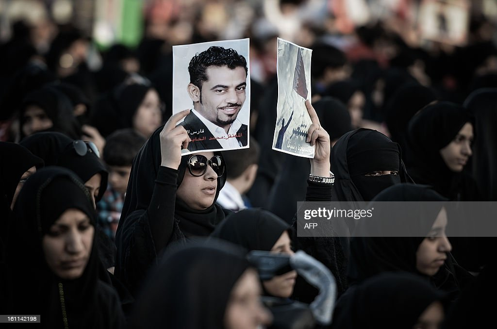 A Bahraini woman holds up a picture of her relative detainee during an anti-government rally to demand reforms on February 9, 2013 in the village of Al Muqsha, west of the Bahraini capital Manama. Bahrain's national dialogue is set to resume on February 10, in an atmosphere of mutual mistrust between government and the opposition ahead of the second anniversary of a Shiite-led uprising that shook the Gulf kingdom.