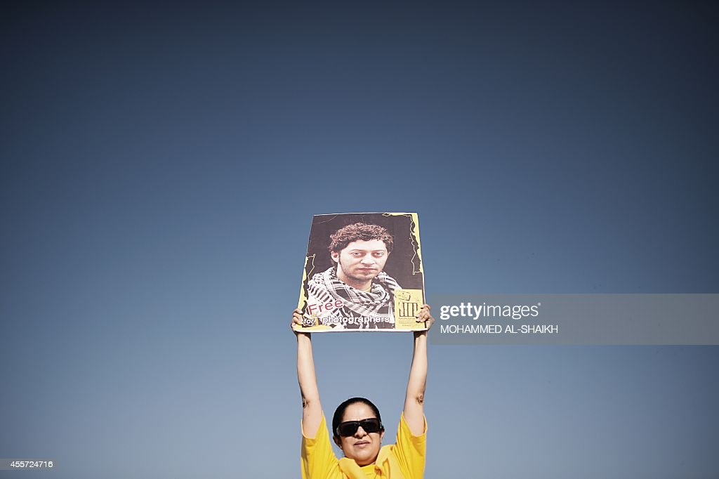 A Bahraini woman holds up a portrait of jailed photographer Ahmed Humaidan during an anti-government protest in the village of Jannusan, west of the capital Manama, on September 19, 2014. Bahrain's opposition is demanding a constitutional monarchy under which the premier is designated by parliament in the Shiite-majority but Sunni-ruled kingdom.