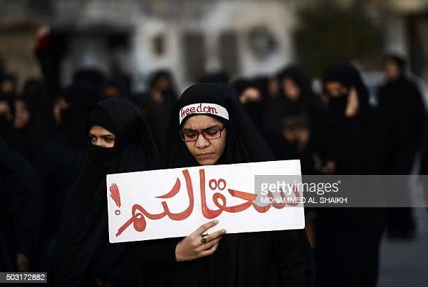 Bahraini woman takes part in a protest in the village of Jidhafs west of Manama against the execution of prominent Shiite Muslim cleric Nimr alNimr...