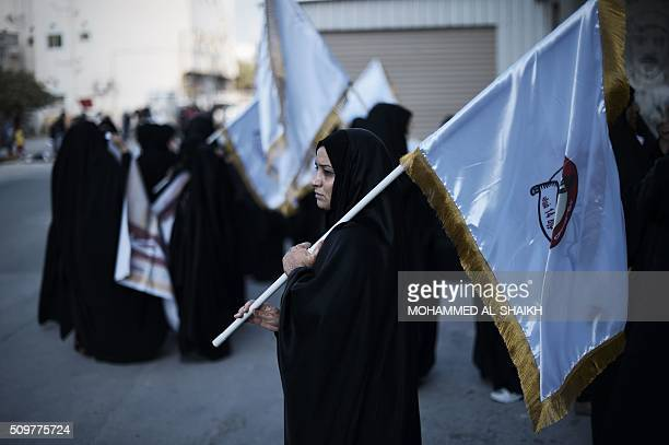Bahraini women hold flags and posters during a demonstration to mark the fifth anniversary of the Arab Springinspired uprising on February 12 in the...