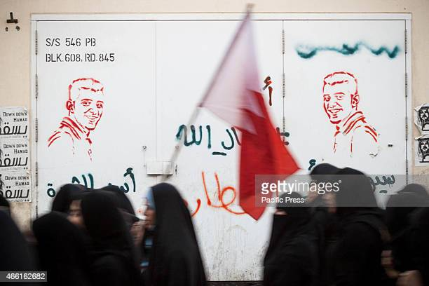 Bahraini women participating in the a demonstration on the anniversary marking the fourth anniversary of the Gulf coalition led by Saudi Arabia and...
