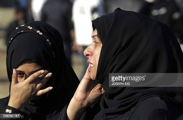 Bahraini women react as thousand antigovernment protesters return to Pearl Square in Manama on February 19 the focal point of bloody antiregime...