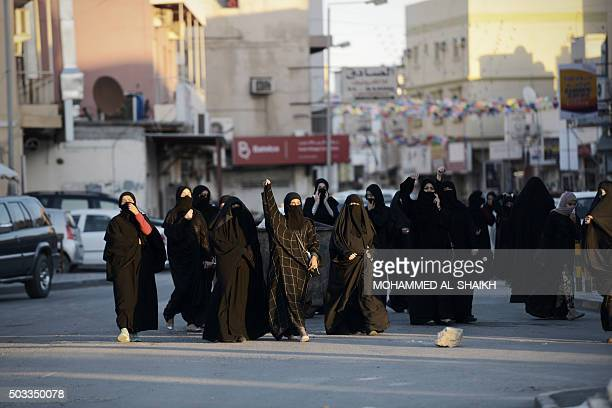 TOPSHOT Bahraini women shout slogan during clashes with riot police following a protest against the execution of prominent Shiite Muslim cleric Nimr...