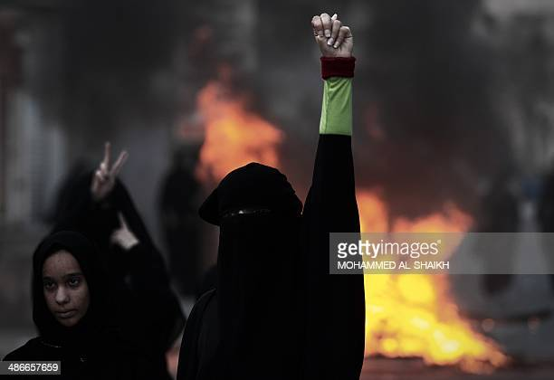 Bahraini women shout slogans during clashes with and riot police following a protest condemning the death of Ahmed AlMosajen and Ali Abbas in the...