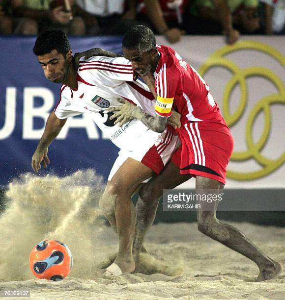 Bahraini Yaqoob Nesuf vies with Iranian Faroogh Dara during their Asian Zone FIFA Beach Football World Cup 2007 runners up final qualifier match in...