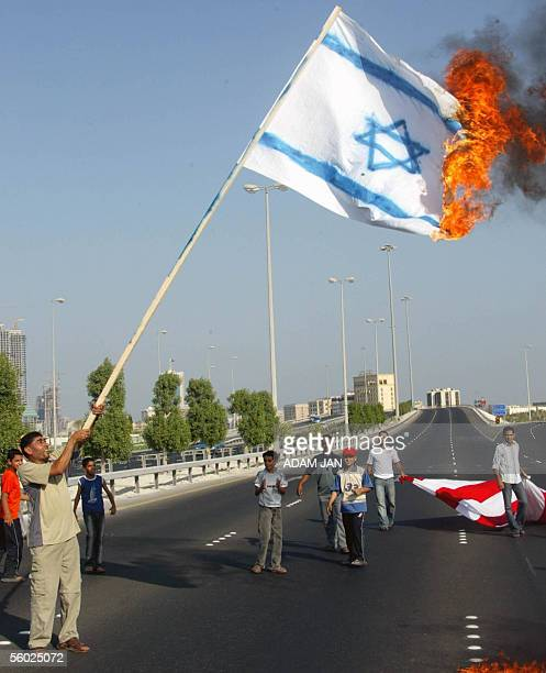 Bahrainis burn an Israeli flag during a demonstration marking Jerusalem day 28 October 2005 in the Bahraini capital Manama Two days ago Iran's...