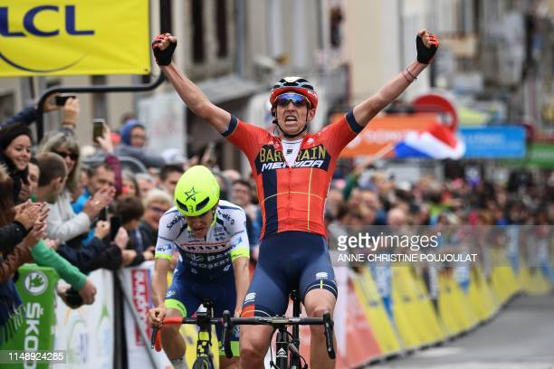 Bahrain-Merida rider Belgium's Dylan Teuns crosses the finish line ahead of Team Wanty-Gobert Cycling Team rider France's Guillaume Martin to win the...