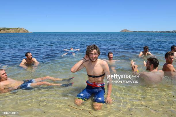 TOPSHOT BahrainMerida rider Manuele Boaro of Italy has a swim in 41 degree Celsius heat with other riders after finishing on the third day of the...
