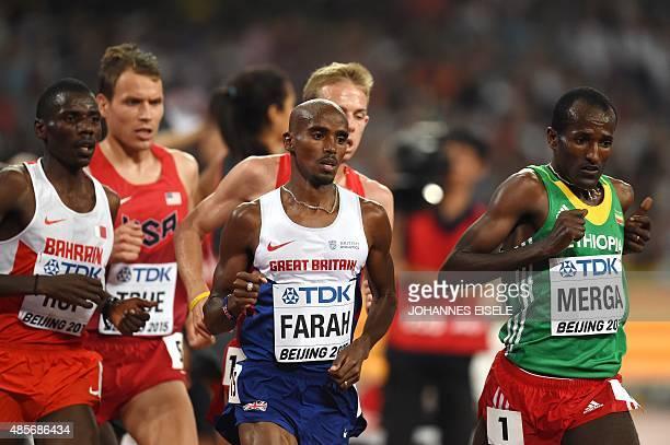 Bahrain's Albert Kibichii Rop Britain's Mo Farah and Ethiopia's Imane Merga compete in the final of the men's 5000 metres athletics event at the 2015...