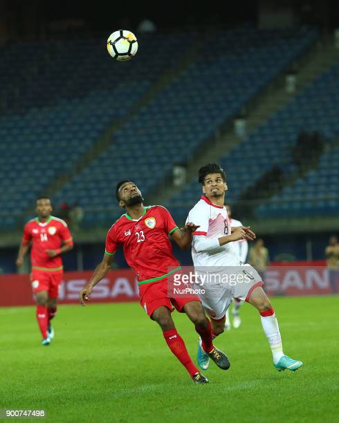 Bahrain's Ebrahim Ahmed Habib fights for the ball against Oman's Harib alSaadi during the 2017 Gulf Cup of Nations semifinal football match between...