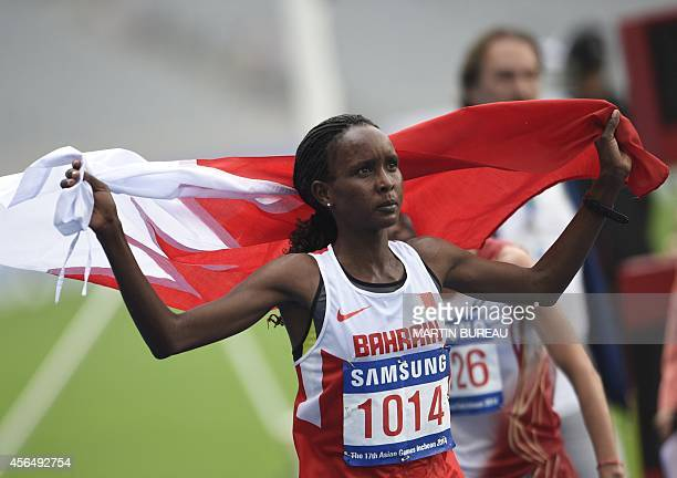 Bahrain's Eunice Jepkirui Kirwa celebrates after victory in the final of the women's marathon athletics event during the 17th Asian Games on the...