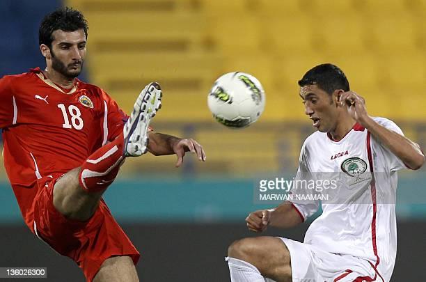 Bahrain's Fahd Hardan challenges Palestine's Ashraf alFawaghra during their 2011 Arab Games football match in the Qatari capital Doha on December 20...