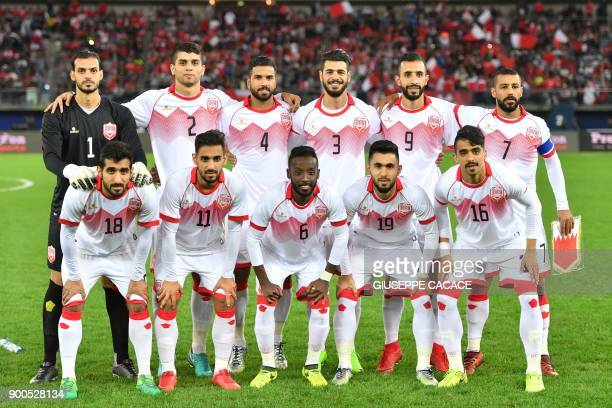 Bahrain's first eleven pose for a team photo during the 2017 Gulf Cup of Nations semifinal football match between Oman and Bahrain at the Sheikh...