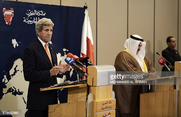 Bahrain's Foreign Affairs Minister Sheikh Khaled bin Ahmed alKhalifa and US Secretary of State John Kerry attend a press conference in the capital...