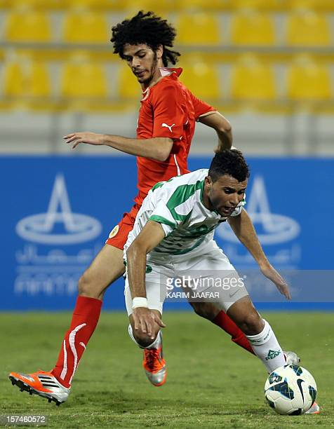 Bahrain's Hassan Jameel Yaseen vies for the ball against Iraq's Walid Salem during their international friendly football match in Doha on December 3...