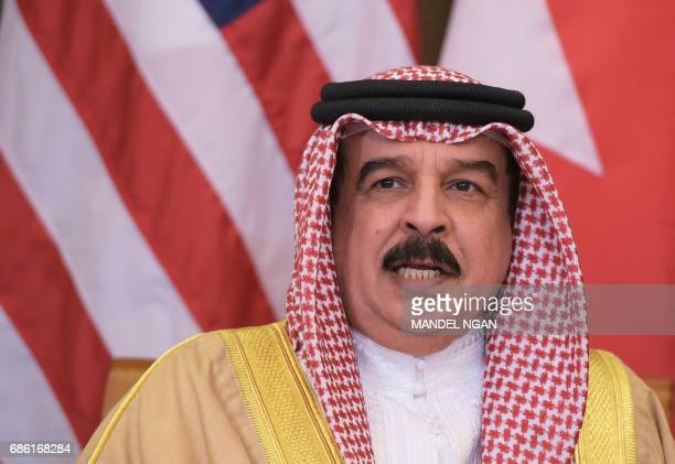 Bahrain's King Hamad bin Isa Al Khalifa takes part in a bilateral meeting with US President Donald Trump at a hotel in Riyadh on May 21 2017 / AFP...