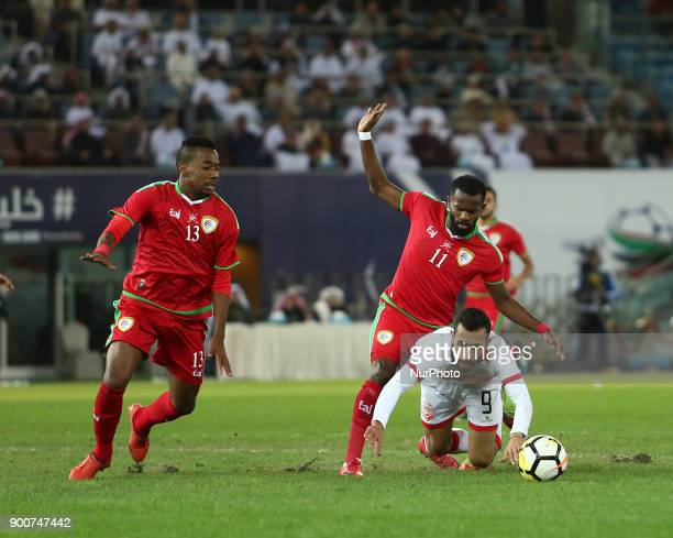 Bahrain's Mahdi Abd alJabar fights during the 2017 Gulf Cup of Nations semifinal football match between Oman and Bahrain at the Sheikh Jaber alAhmad...