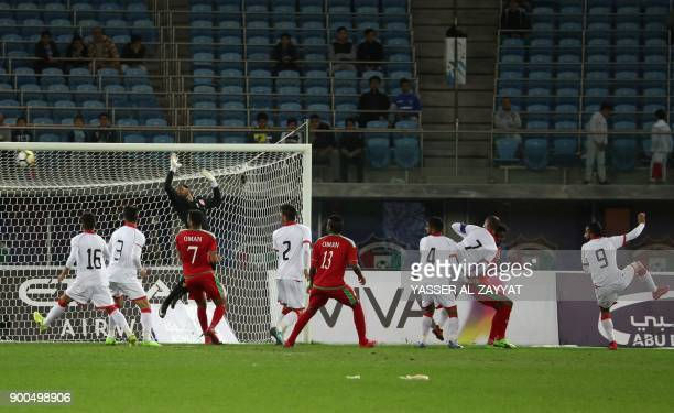 Bahrain's Mahdi Abd alJaber scores an own goal during the 2017 Gulf Cup of Nations semifinal football match between Oman and Bahrain at the Sheikh...