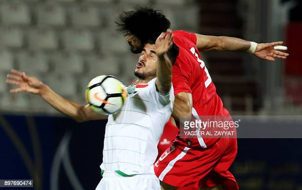 Bahrain's midfielder Waleed Al Hayam vies for the ball against Iraq's forward Ayman Hussein during their 2017 Gulf Cup of Nations football match...