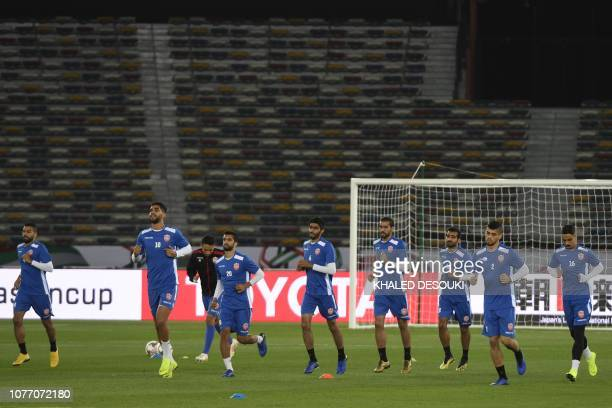 Bahrain's national team players attend a training session at Zayed Sports City stadium in Abu Dhabi on January 4 a day before their opening match...