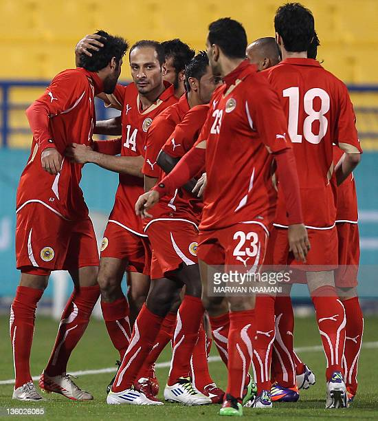 Bahrain's players celebrate after scoring a goal against Palestine during their 2011 Arab Games football match in the Qatari capital Doha on December...