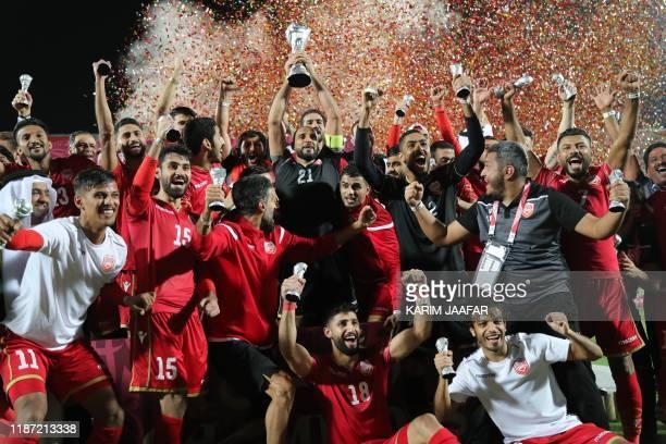 Bahrain's players celebrate after winning the 24th Arabian Gulf Cup Final football match between Bahrain and Saudi Arabia at the Khalifa...