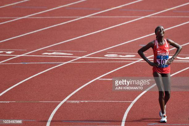 TOPSHOT Bahrain's Rose Chelimo reacts after winning the women's marathon athletics event during the 2018 Asian Games in Jakarta on August 26 2018