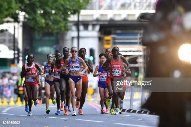 Bahrain's Rose Chelimo, US athlete Amy Cragg and Kenya's Edna Ngeringwony Kiplagat compete in the Women's Marathon during day three of the 16th IAAF...