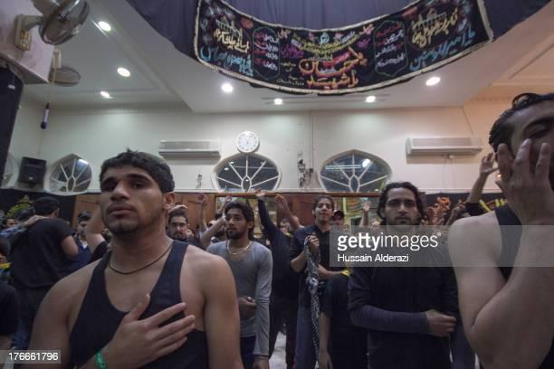 CONTENT] Bahrain's shiite men celebrate during Ashura season in Mattamem Alqasab Manama