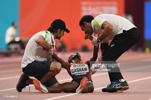 TOPSHOT Bahrain's Tigist Gashaw receives medical attention in the Women's 5000m heats at the 2019 IAAF Athletics World Championships at the Khalifa...