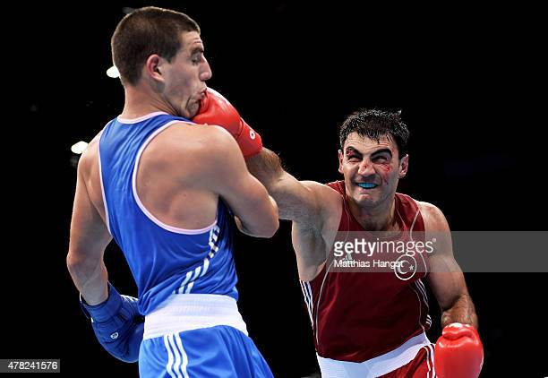 Bahram Muzaffer of Turkey and Josip Bepo Filipi of Croatia blue compete in the Men's Boxing Middleweight Quarter Final during day twelve of the Baku...