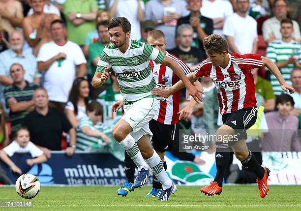 Bahrudin Atajic of Celtic storms past the Brentford defence during a pre season friendly match between Brentford and Celtic at Griffin Park on July...