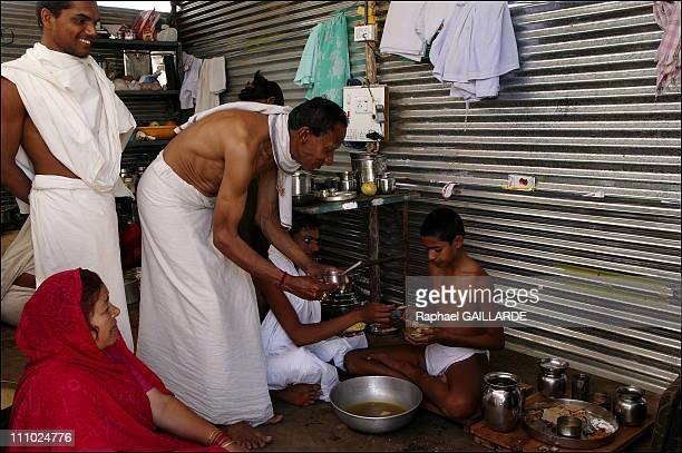 Bahubali, a giant of peace and colors - A young digambara monk has his meal at the ascetics village - Devoted Jains, wearing white, have the great...