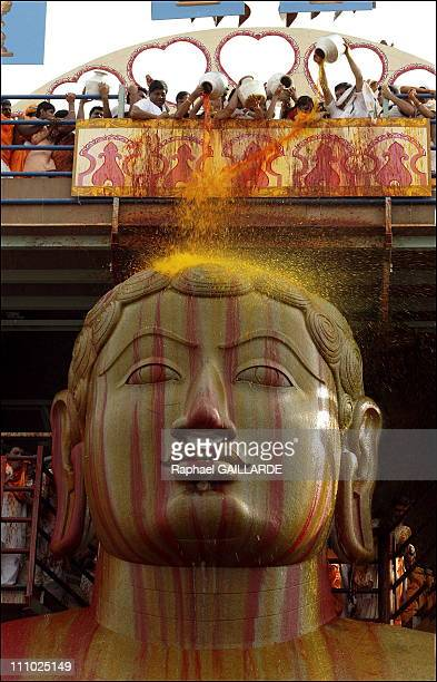 Bahubali a giant of peace and colors Bahubali's stone face bathed in saffron The precious liquid is the last to be poured over the statue and falls...
