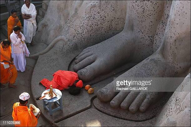 Bahubali a giant of peace and colors Wearing bright orange hues Bhattaraka Sri Charukeerthi a religious authority in Shravanabelagola collects his...