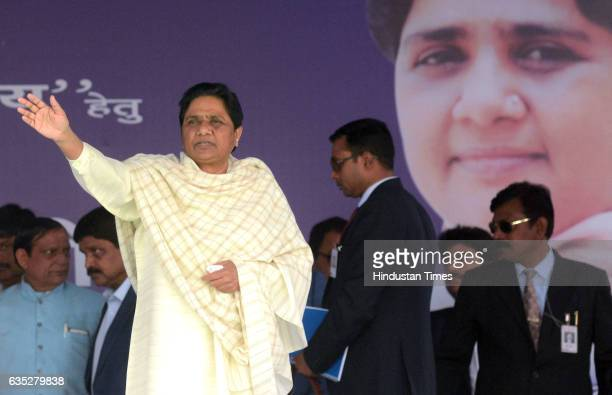 Bahujan Samaj Party Chief Mayawati waving at the crowd at an election rally on Hardoi Road on February 14 2017 in Lucknow India Pitching the Bahujan...