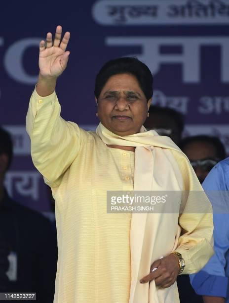 Bahujan Samaj Party president Mayawati waves to the crowd during a rally in New Delhi on May 10 2019