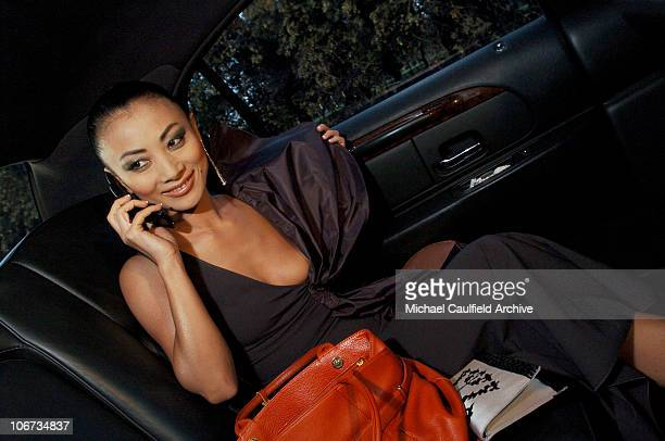 Bai Ling speaks to her manager on the way to her premiere