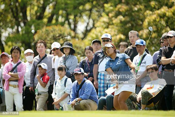 BAi Suzuki of Japan chips onto the 5th green during the final round of the CyberAgent Ladies Golf Tournament at the Grand Fields Country Club on May...