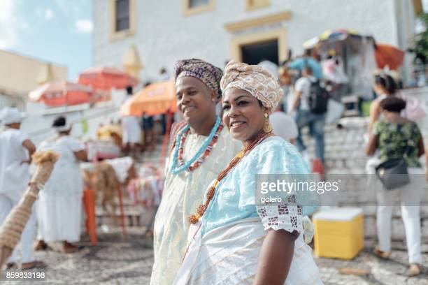 baiana and baiano in traditional costume in front of church in Salvador