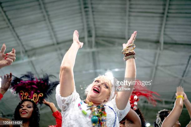 baiana (traditional northeast brazilian woman) celebrating and dancing brazilian carnival at school carnival - parade stock pictures, royalty-free photos & images