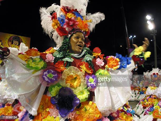 A baiana the wing of Carnaval dancers comprised of older women spins along the Carnaval runway in Rio de Janeiro in the early morning hours of...