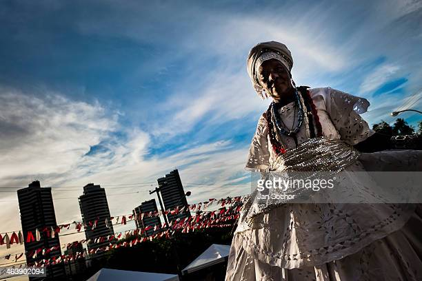Baiana woman climbs the stairs before the ritual dance in honor to Omolú the Candomblé spirit syncretized with Saint Lazarus in front of the St...