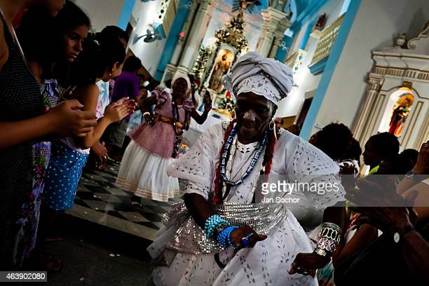 Baiana woman performs the ritual dance in honor to Omolú the Candomblé spirit syncretized with Saint Lazarus inside the St Lazarus church on January...