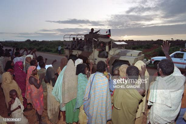 "Baidoa residents cheers a vehicle from the 2nd French Foreign Legion Airborne regiment on December 16, 1992 as part of the ""Restore Hope"" military..."
